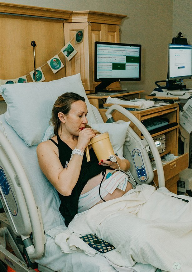 pregnant mom drinking water at the hospital