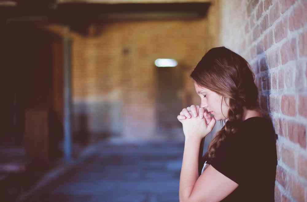 6 Ways To Break Down Spiritual Barriers The Navigators Woman Praying Against Brick Wall