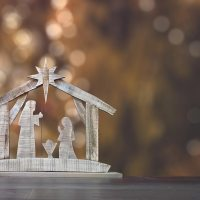 Prayers to Keep Christ in Christmas | The Navigators Prayer Resource | Ornamental nativity scene with Christmas tree background