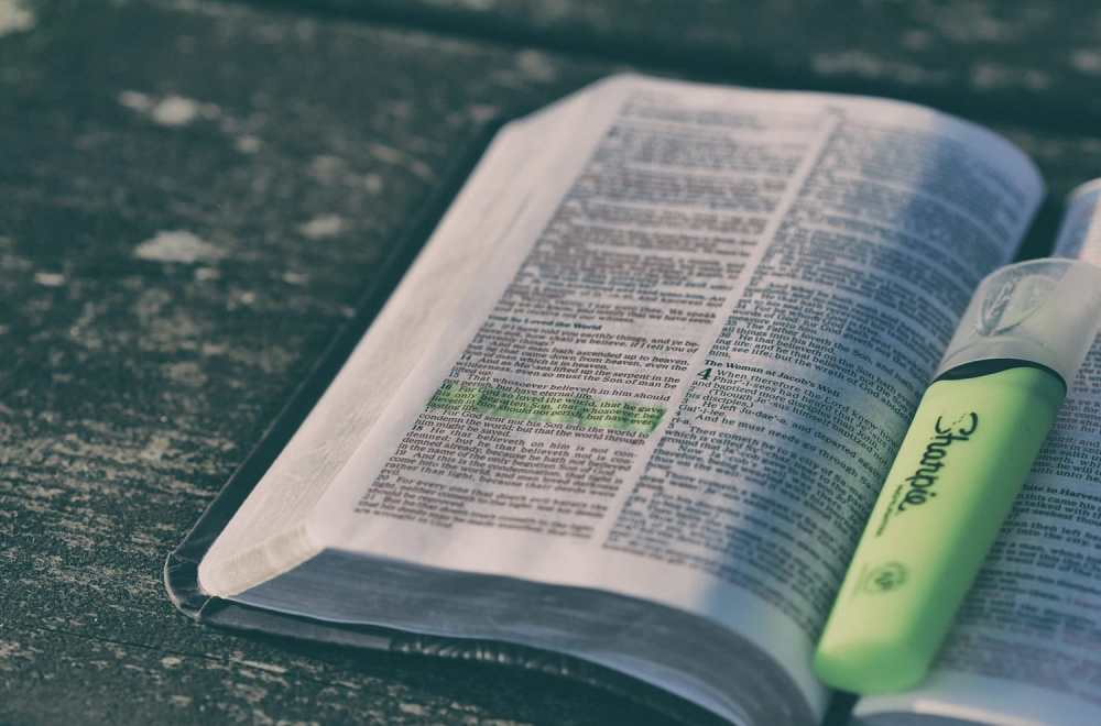 Bible Reading Plans | The Navigators Evangelism Resources | Bible on a wooden table with a highlighter