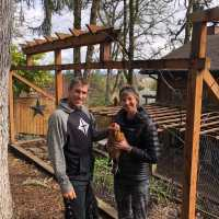 Loving Our Neighbors When We Are All At Home | Navigators Neighbors | John & Stephanie Winder posing with one of their chickens