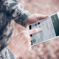 Life-to-Life Disciplemaking Continues to Grow Online | US military soldier using WhatsApp on a digital tablet
