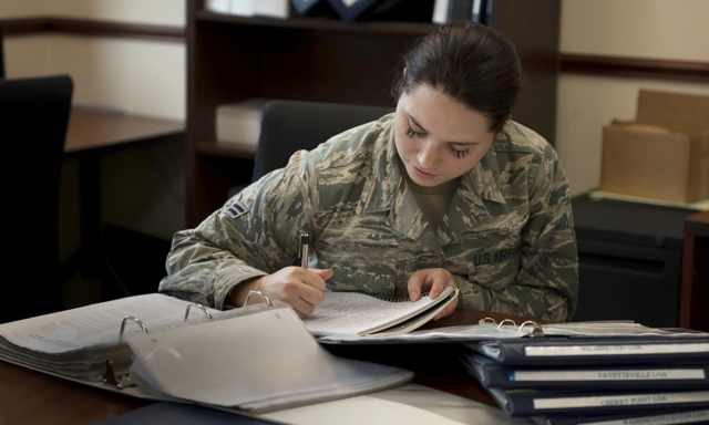 Hope in the Desert | Navigators Military | Woman in uniform writing in notebook