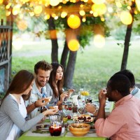 Four Weeks of Thankfulness | Bible Study Resource | Friends celebrating Thanksgiving at a table in fall