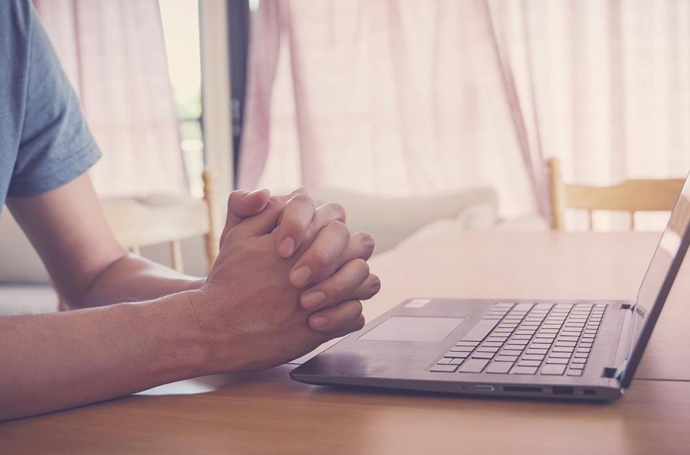 Prayer Teams Make a Difference: God is at Work | The Navigators Collegiate Ministry | Praying hands on a laptop