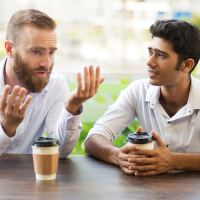 Help for Depression: How Do You Know if You're Drowning? | The Navigators Collegiate Ministry | Two male friends drinking coffee and talking in outdoor cafe