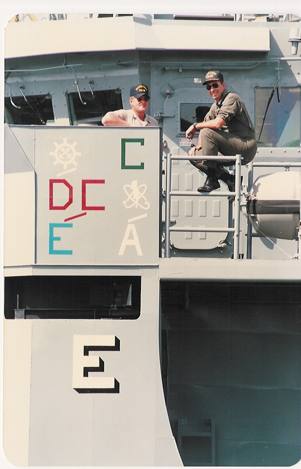 Cmdr. Paul X. Rinn, right, the <i>Roberts'</i> commanding officer, and BMCS (SW) George Frost, the crew's senior enlisted sailor, pose on the frigate's port bridge wing above the ship's various Battle Efficiency awards in mid-1988. (Courtesy Paul X. Rinn)