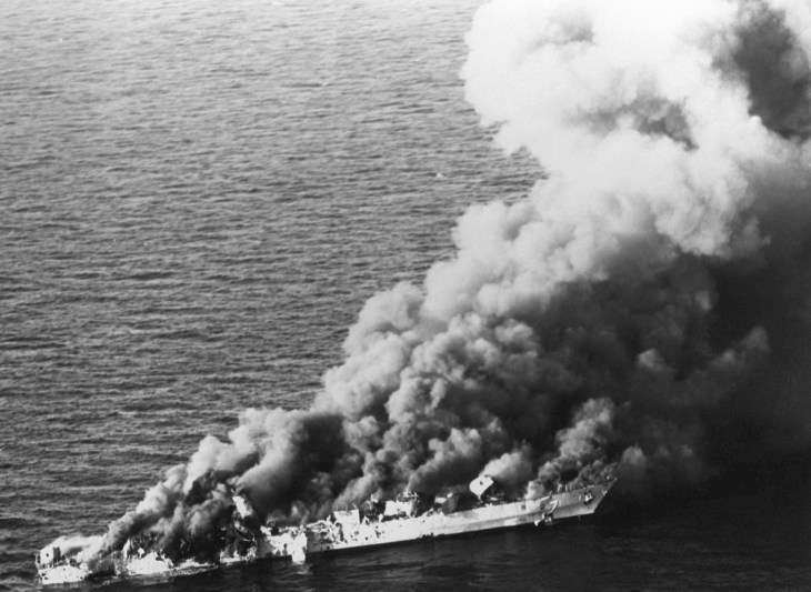 The Iranian frigate IS Sahand (F 74) burns after being attacked by the Joseph Strauss and A-6s. Sahand was hit by three Harpoon missiles, Skipper rocket-propelled bombs, a Walleye laser-guided bomb, and several 1,000-pound bombs. U.S. NAVY PHOTO