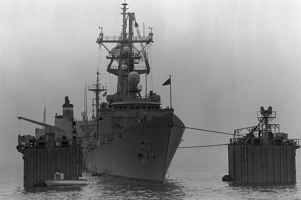<i>Roberts</i>begins to float free. (PH2 Elliott/U.S. Navy)