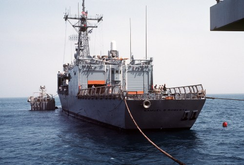 Steel cables are attached to hold<i>Roberts</i>in place above MS2. (PH2 Michael Harnar/U.S. Navy)