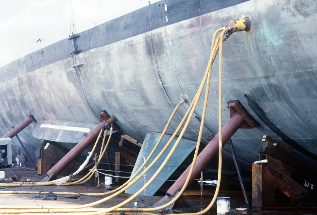 A close-up view of supports anchoring the guided missile frigate USS SAMUEL B. ROBERTS (FFG-58) aboard the deck of the Dutch heavy-lift ship MIGHTY SERVANT II.  The MIGHTY SERVANT will transport the frigate, which was damaged when it struck an Iranian mine on April 14, 1988, to its home port in Newport, R.I.