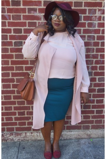plus size black girl wearing fall pink and green outfit with burgundy floppy hat