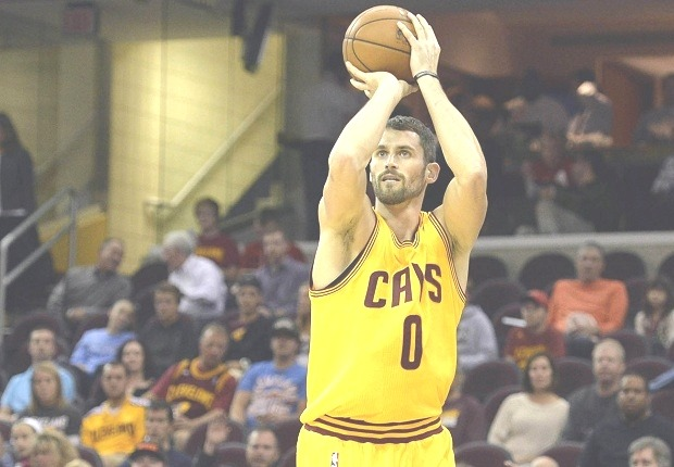 Oct 14, 2014; Cleveland, OH, USA; Cleveland Cavaliers forward Kevin Love (0) shoots a three-point basket in the first quarter against the Milwaukee Bucks at Quicken Loans Arena. Mandatory Credit: David Richard-USA TODAY Sports