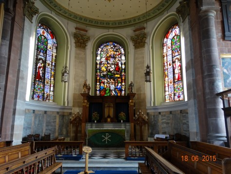 The beautiful stained glass windows fitted in the 19th century to replace the plain glass
