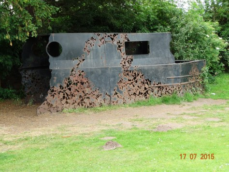 A narrowboat sculpture in the Mere park