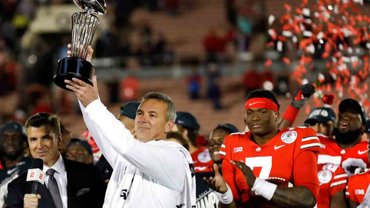 Dwayne Haskins and Urban Meyer_1546469574981.jpg.jpg