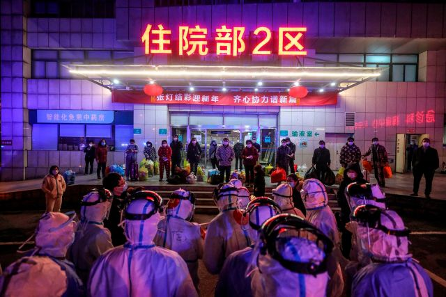 Covid-19 patients wait to be transferred from Wuhan No. 5 Hospital to Leishenshan Hospital, the newly-built hospital for coronavirus patients in Wuhan.