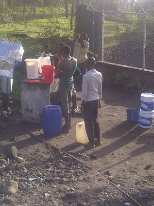 Some Resident of Georgetown waiting collecting water