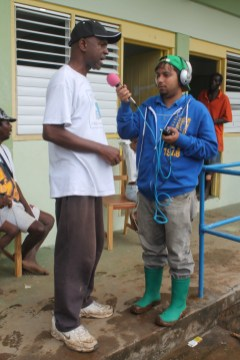 The Hon Maxwel Charles Speaking to NBC Radio Announcer Colvin Harry On the aftermarth of the flash flood.