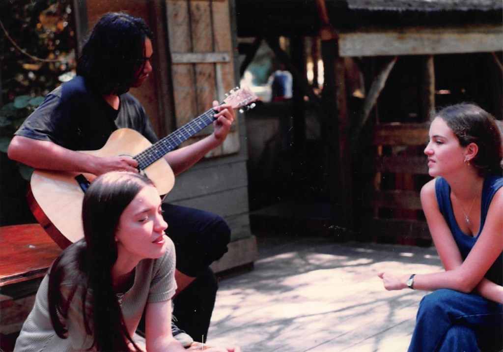 3 campers playing music and singing in 1996