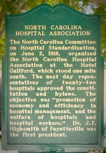 Historic marker in Greensboro, NC, explaining the beginning of the NC Hospital Association.
