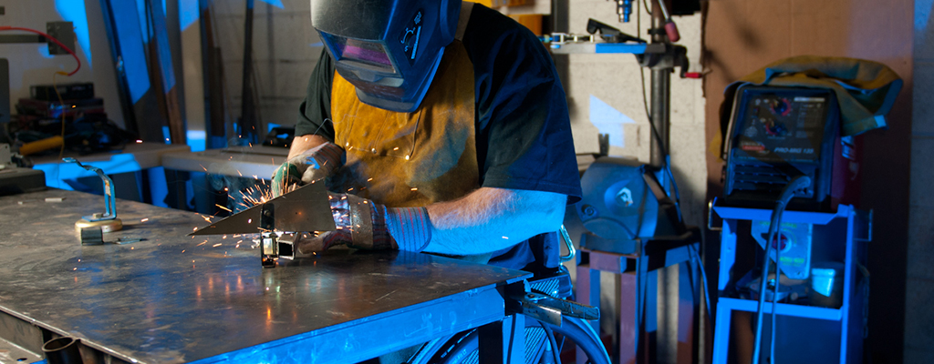 Photo by Arizona Bridge to Independent Living – a welder with a disability