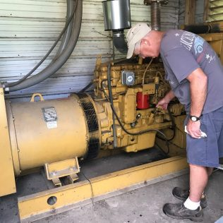 Having a generator on the farm essential for when the farm loses power during a storm. A generator guarantees that the pigs have access to feed, water and airflow. Jack checks to make sure the generator is in good working order (left) and that there is plenty of fuel to run the generator (right).