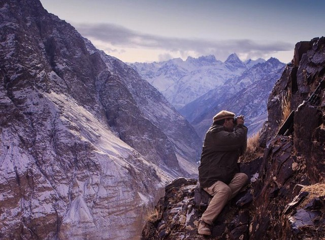 This shows how incredibly treacherous the Himalayan Mountains are. Here's a picture of a guide checking for ibex on a near vertical cliff.