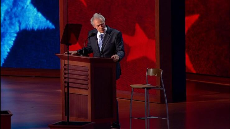 Exaggerated: photo of Clint Eastwood talking at an empty chair at the Rep*blican Convention in 2012.