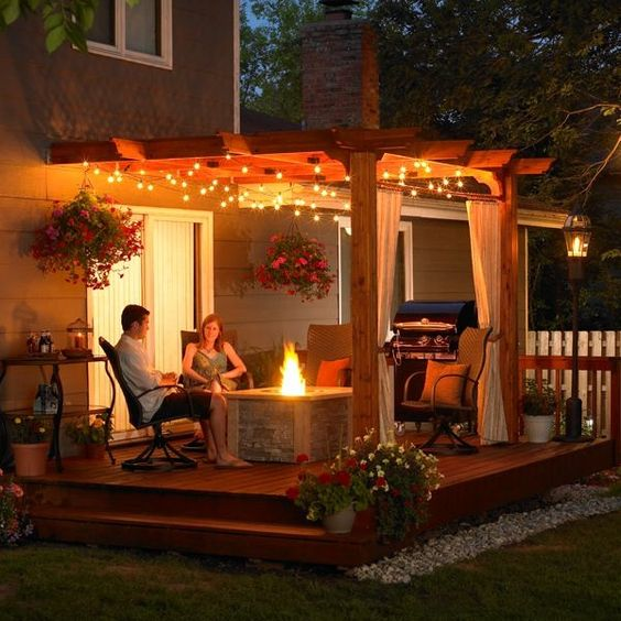 small wooden deck with fire pit