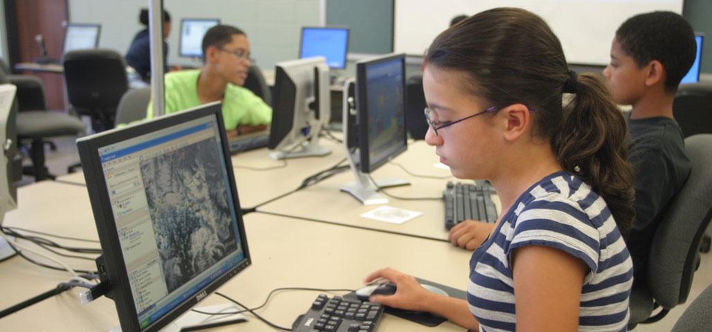 Teen in front of computer