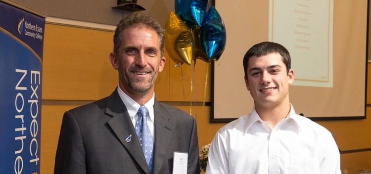 Lane Glenn next to a happy scholarship winner