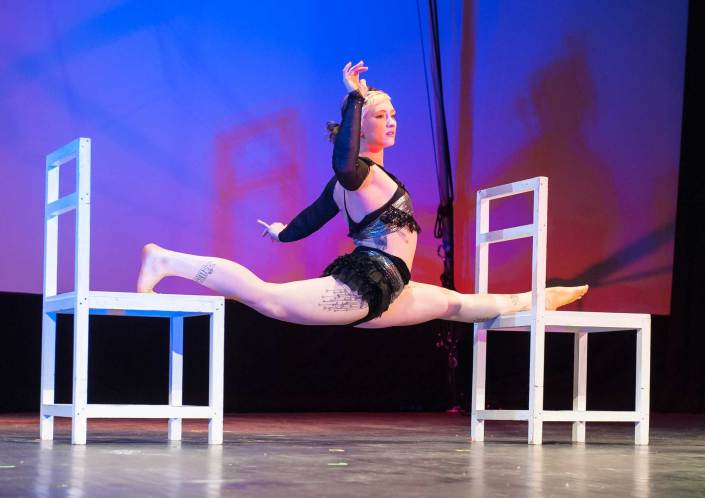 photo of Chloe Wailer performing a split at NECCA's Circus Spectacular in brattleboro vermont
