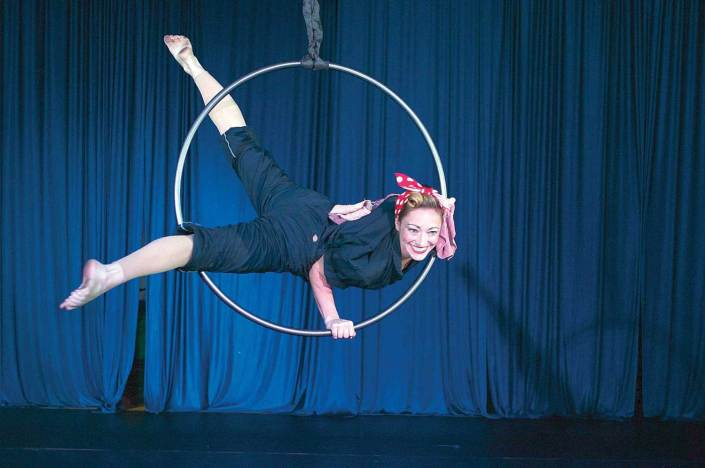 aerial hoop artist performing on stage