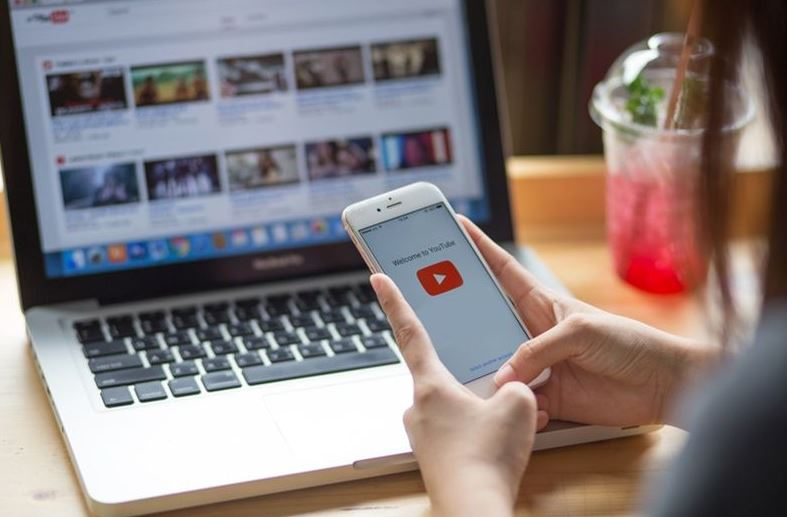 using iPhone and laptop in accessing Youtube app