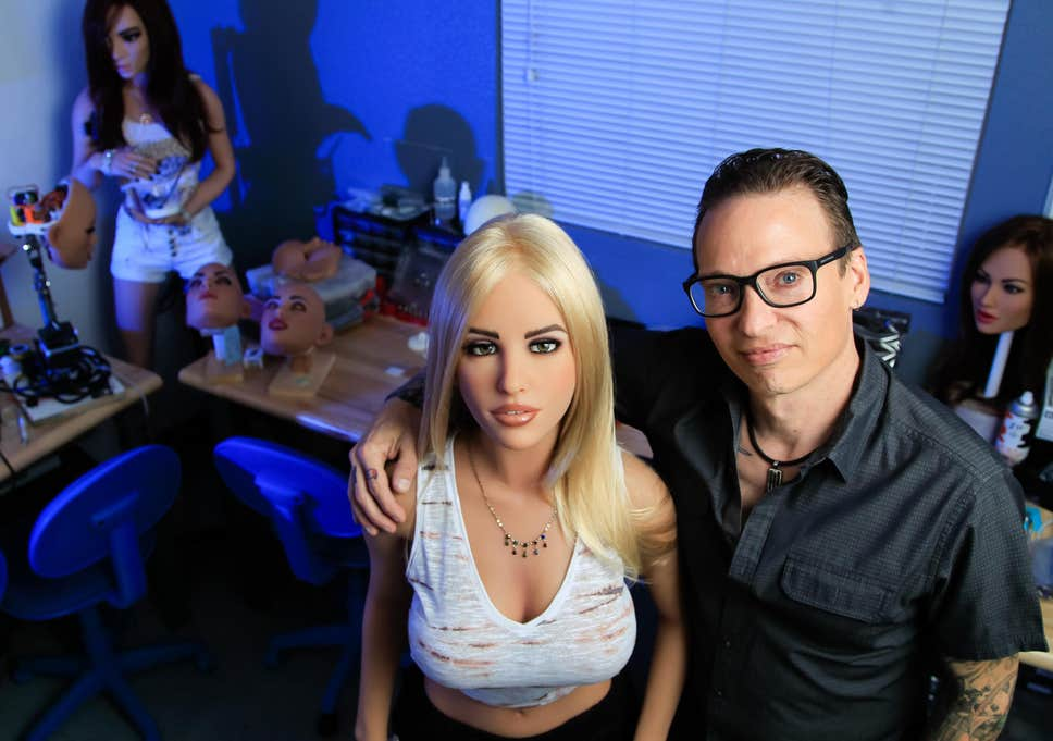 robot sex dolls standing with man