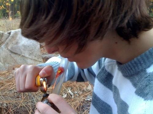 man smoking cannabis resin