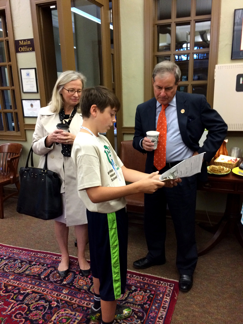 Congressman Yarmuth meeting with a student