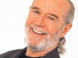 George Carlin grinning