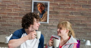 Aaron Taylor-Johnson and Chloe Grace Moretz while Nicolas Cage looks on, from Kick-Ass 2
