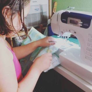 Rhea getting to use her sewing machine to create gifts for her friends!