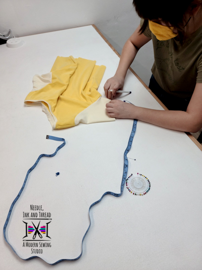 Ms. E learning how to draft a tee shirt pattern from another shirt!