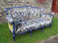Designer upholstered Statement Piece sofa, with botanical-themed scene from 'Arley House' and Designers Guild velvet.