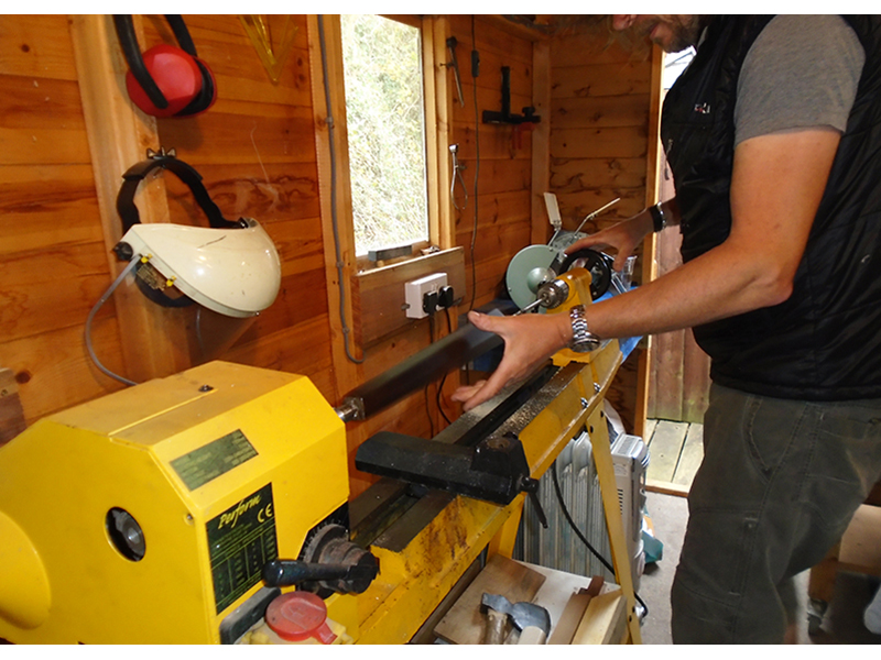 Gord hard at work using the lathe for woodwork in the workshop