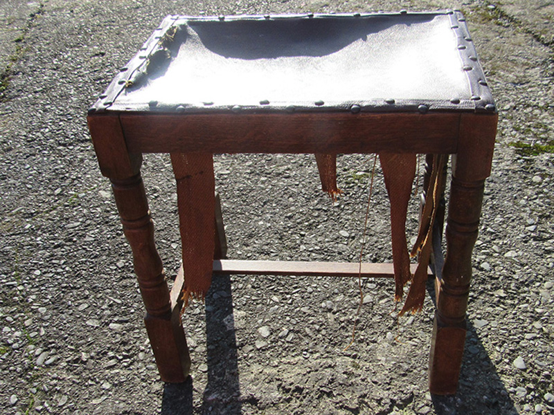 This welsh stool had it's upholstery removed and the woodwork frame was re-glued.