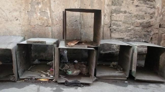 six broken looking boxes