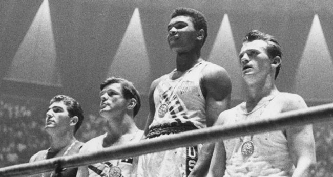 Photo of Muhammad Ali and three others at the Olympics