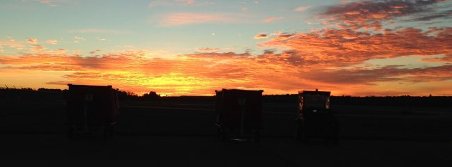 picture of sunset and farm equipment