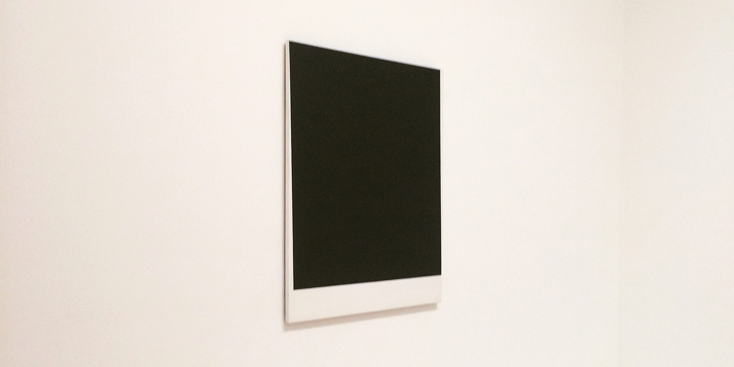 Blank black and white canvas on wall