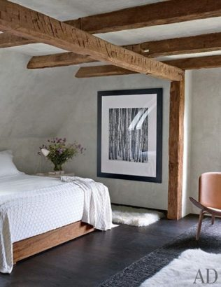 Timber frame and rough stucco meet in this upstate New York bedroom by Bonetti/Kozerski Studio. Photo by William Waldron, from the July 2012 issue of Architectural Digest.